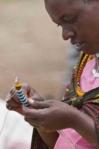 Maasai woman beading