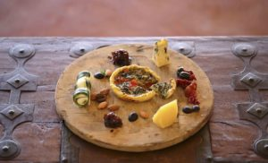 Vegetable tart cheeses onion marmalade and nuts