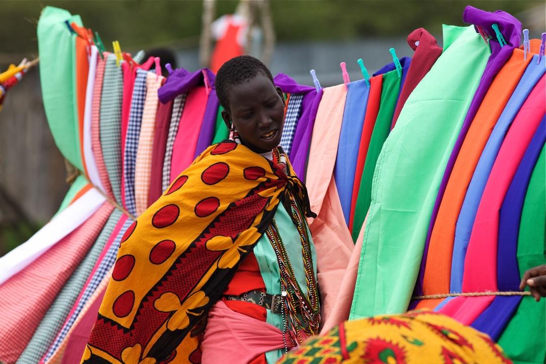 Maasai lady at market by Luigi Massimeo