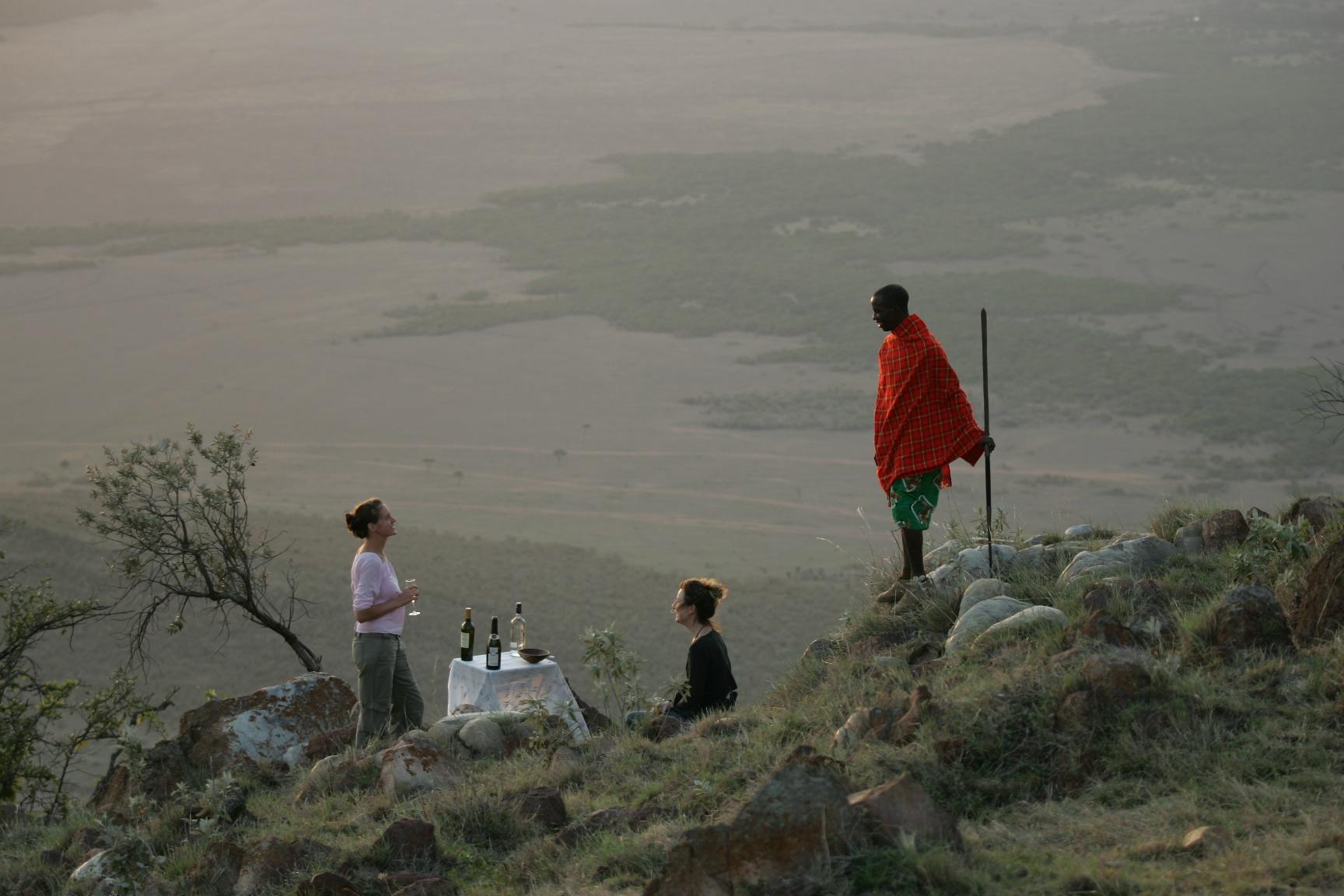 Sundowners with local Maasai guide