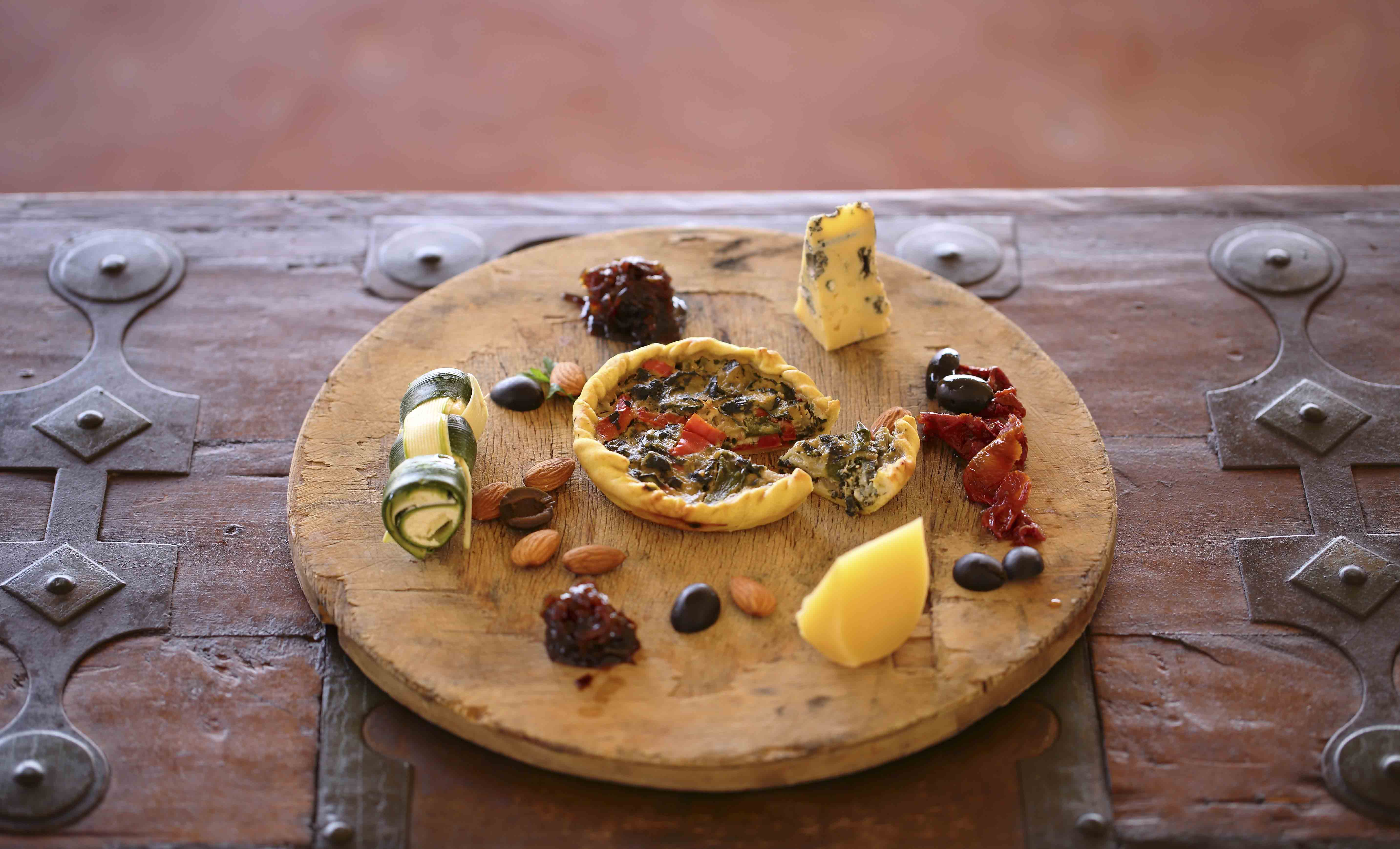 Vegetable tart cheeses onion marmalade and nuts 2